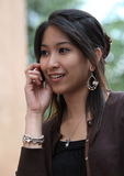 Young woman calling. On her cell phone Royalty Free Stock Photo