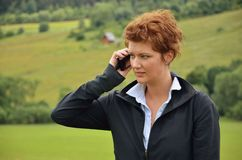 Young woman is calling. On the meadow Stock Photo