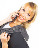 Young woman calling by cellular phone Stock Image