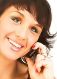 Young woman calling by cellular phone. Attractive young woman calling by cellular phone. Isolated over white.r Royalty Free Stock Photography