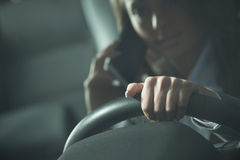 Young woman calling while driving Stock Images