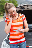 Young woman calling with her mobile phone Stock Image