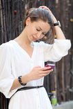 Young woman calling by phone Royalty Free Stock Image