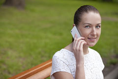 Young woman calling by phone. Young happy woman calling by phone Royalty Free Stock Photos