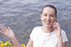 Young woman calling by phone. Young happy woman calling by phone Stock Image