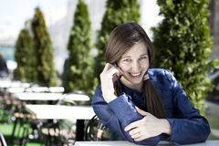 Young woman calling by phone. Young happy woman calling by phone Stock Photography