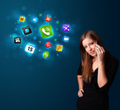 Young woman calling by phone with various icons Stock Images