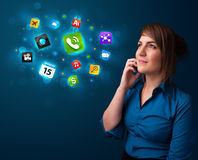 Young woman calling by phone with various icons Royalty Free Stock Photography