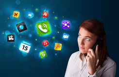 Young woman calling by phone with various icons Stock Photo