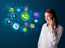 Young woman calling by phone with various icons Stock Image