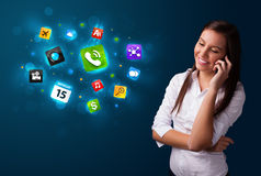 Young woman calling by phone with various icons Stock Photos