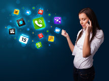 Young woman calling by phone with various icons Royalty Free Stock Photos
