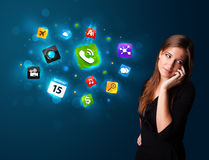 Young woman calling by phone with various icons Stock Photography