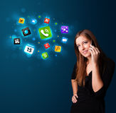 Young woman calling by phone with various icons. Attractive young woman calling by phone with various icons Royalty Free Stock Photo
