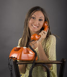 Young woman calling on the retro phone Royalty Free Stock Images