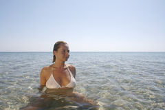 Young woman in the calm sea. Royalty Free Stock Photos