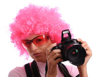 Young woman with camera Royalty Free Stock Photography