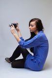 Young woman with camera. Young happy woman holding small video camera.at white background Stock Photo