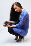 Young woman with camera. Young happy woman holding small video camera.at white background Stock Images