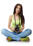 Young woman with camera. Royalty Free Stock Photo