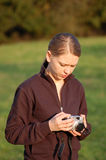 Young Woman with a Camera Stock Photo