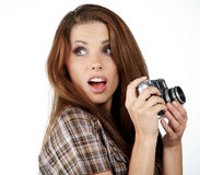 Young woman with camera. Stock Images