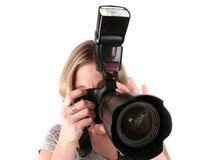 Young woman with camera. Isolated over white royalty free stock image