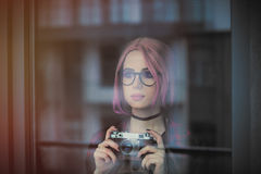 Young woman with camera Stock Images