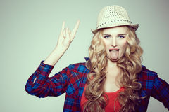 Young woman with camera. Blonde in a plaid shirt. Hipster fashion Royalty Free Stock Photography