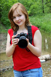 Young woman with camera near river Royalty Free Stock Photo