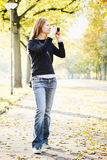 Young Woman with a Camera in a Park Stock Image