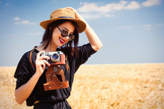 Young woman with camera Stock Photography