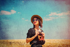 Young woman with camera Stock Image