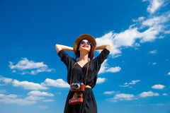 Young woman with camera Royalty Free Stock Images