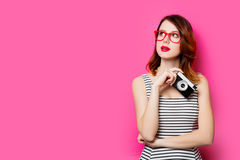 Young woman with camera Royalty Free Stock Photos
