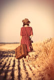 Young woman with camera and suitcase stock photography