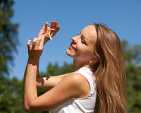 Young woman with camomile Stock Images