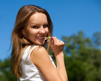 Young woman with camomile Royalty Free Stock Images