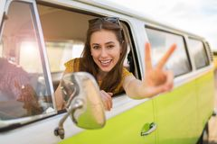 Young woman enjoying a road trip. Young woman in a camper van, smiling Royalty Free Stock Photos
