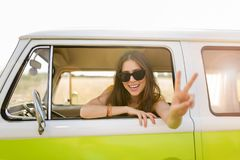 Young woman enjoying a road trip. Young woman in a camper van, smiling Royalty Free Stock Photography