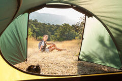 Young woman in a camping stock photo