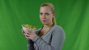 Young woman can not eating the fresh green grapes and she laughs stock footage
