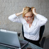 Young woman can't handle workload Stock Photo