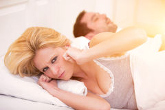 Young woman can't sleep because of boyfriend's snoring Royalty Free Stock Photos