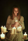 Young woman with candle in hand Royalty Free Stock Photos