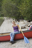 Young woman in a canoe holding the paddle Royalty Free Stock Image