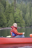Young woman canoeing Stock Photos