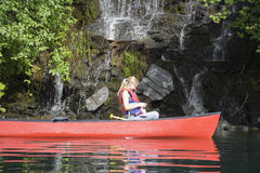 Young woman canoeing Stock Image