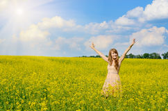 Young woman at canola field Stock Image