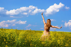Young woman at canola field Stock Photography